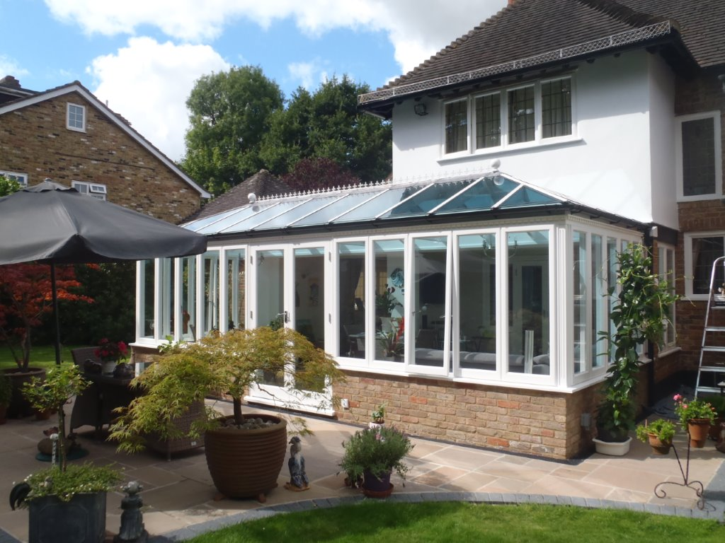 A Conservatory with Brickwork, bespoke design and construction by Trustwood of Brentwood.