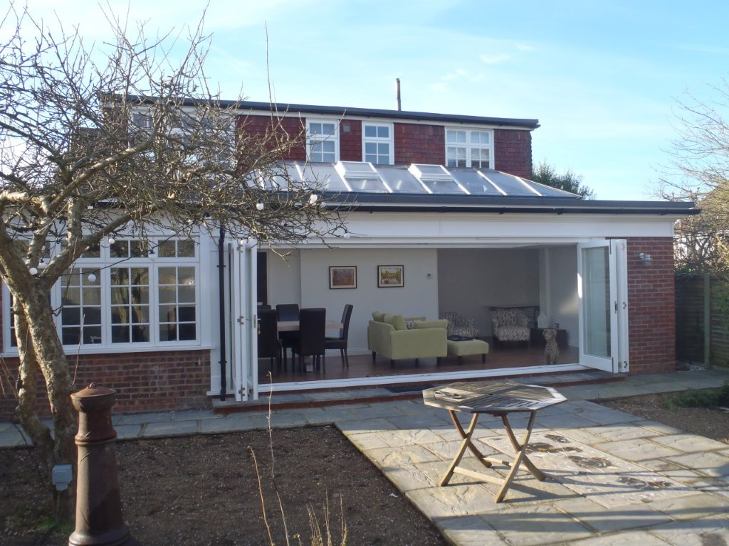 Orangeries in Essex with folding doors open.